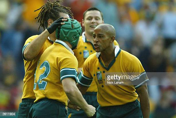 George Gregan congratulates Elton Flatley of Australia during the Rugby World Cup Pool A match between Australia and Romania at Suncorp Stadium...