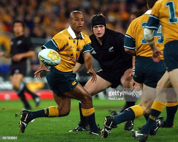 George Gregan flicks a pass watched by Richard McCaw during the TriNations Bledisloe cup rugby match at Stadium Australia Sarturday won by the...