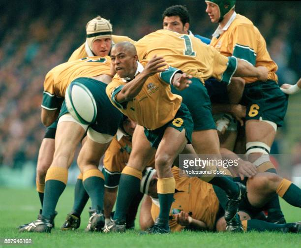 George Gregan of Australia passes the ball during their rugby union World Cup final match against France at the Millennium Stadium in Cardiff on 6th...