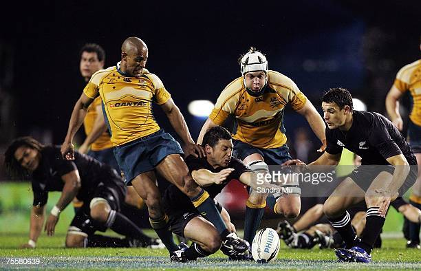 George Gregan of the Wallabies and Byron kelleher of the All Blacks scramble for the ball as Stephen Hoiles and Daniel Carter follow in support...