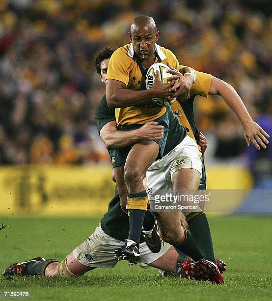 George Gregan of the Wallabies is tackled during the Tri Nations series second Mandela plate match between Australia and South Africa at Telstra...