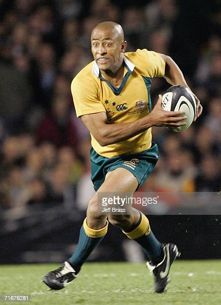George Gregan of the Wallabies runs with the ball during the Tri Nations series Bledisloe Cup match between the New Zealand All Blacks and the...