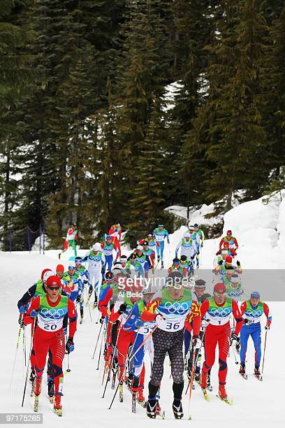 George Grey of Canada competes with Martin Johnsrud Sundby of Norway during the Men's 50 km Mass Start Classic crosscountry skiing on day 17 of the...