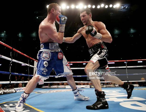 George Groves in action with Carl Froch in their IBF and WBA World Super Middleweight bout at Wembley Stadium on May 31 2014 in London England
