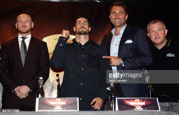 George Groves Jamie Cox Eddie Hearn and John Costello pose for a photo during a press conference ahead of the World Boxing Super Series fight between...