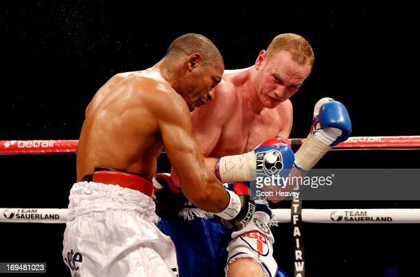 George Groves of England catches Noe Gonzalez of Uruguay to knock him out during their International Super Middleweight bout at the O2 Arena on May...