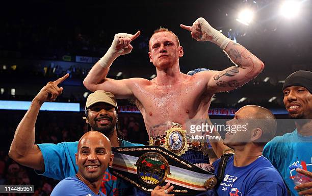 George Groves of England celebrates defeating James DeGale of England with David Haye in the British and Commonwealth SuperMiddleweight Championship...