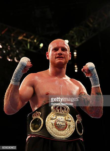 George Groves of England celebrates with the belt after defeating David Brophy of Scotland during the WBA International SuperMiddleweight title fight...