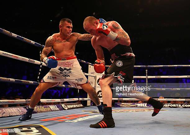 George Groves of Great Britain and Martin Murray of Great Britain exchange blows during their WBA International SuperMiddleweight Championship...