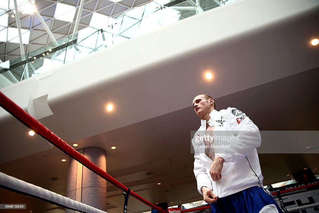 George Groves puts his jacket on after the George Groves Media Work Out at Westfield Shopping Centre Shepherds Bush on May 27, 2014 in London, England.