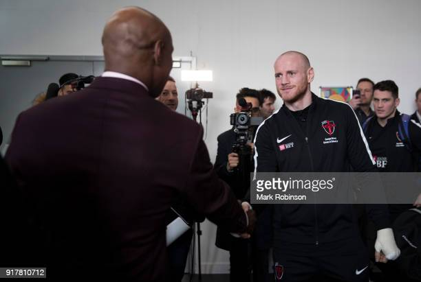 George Groves shakes hands with Chris Eubank before he takes part in a public work out at National Football Museum on February 13 2018 in Manchester...