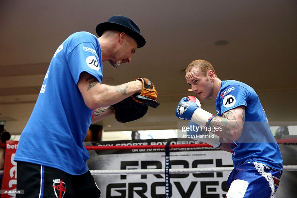 George Groves (R) works out with his trainer Barry Fitzpatrick during the George Groves Media Work Out at Westfield Shopping Centre Shepherds Bush on May 27, 2014 in London, England.
