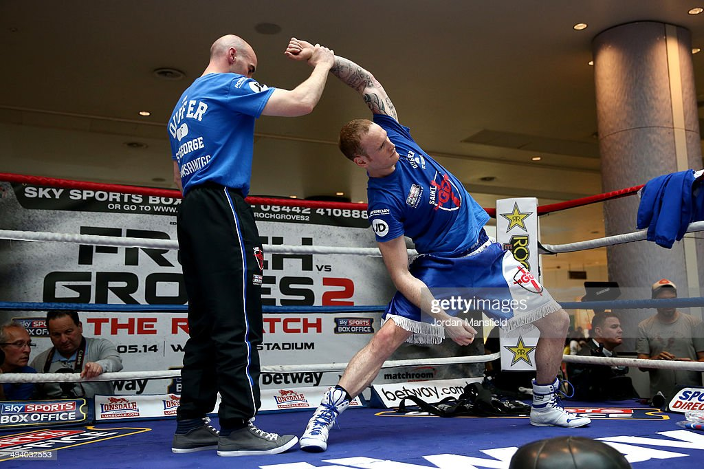 George Groves works out with his trainer Barry Fitzpatrick during the George Groves Media Work Out at Westfield Shopping Centre Shepherds Bush on May 27, 2014 in London, England.