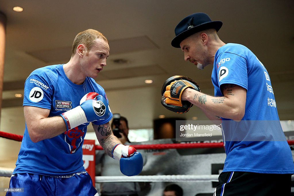 George Groves (L) works out with his trainer Barry Fitzpatrick during the George Groves Media Work Out at Westfield Shopping Centre Shepherds Bush on May 27, 2014 in London, England.