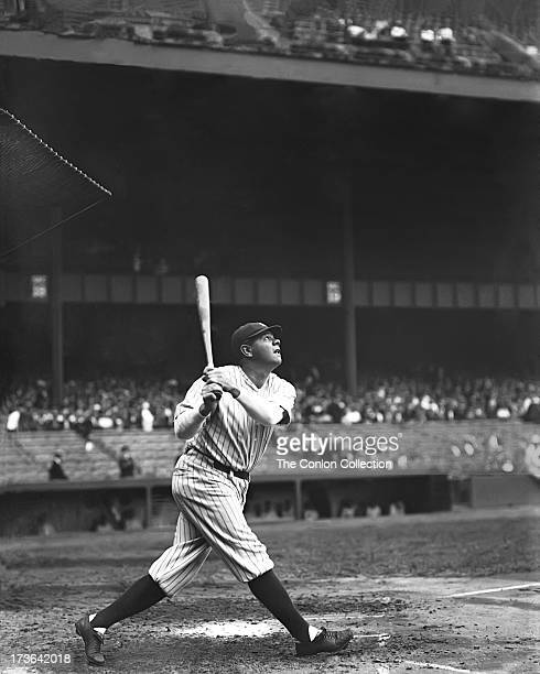 George H Ruth of the New York Yankees swinging a bat in 1925