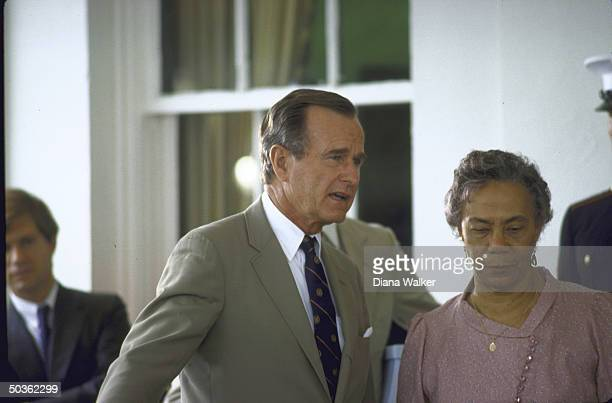 George H W Bush with Dominica's PM M Eugenia Charles at WH during world conservative leaders meeting