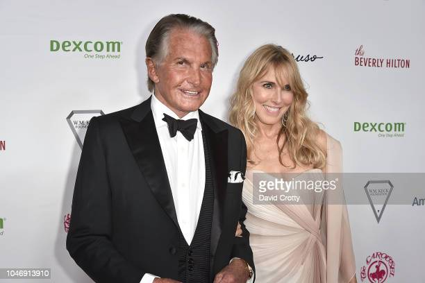 George Hamilton and Alana Hamilton Stewart attend the 2018 Carousel Of Hope Ball at The Beverly Hilton Hotel on October 6 2018 in Beverly Hills...