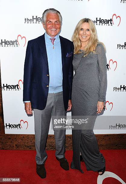 George Hamilton and Alana Stewart attend The Heart Foundation event at Ron Burkle's Green Acres Estate on May 21 2016 in Beverly Hills California