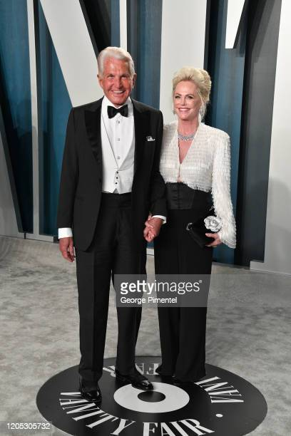 George Hamilton and Barbara Sturm attend the 2020 Vanity Fair Oscar party hosted by Radhika Jones at Wallis Annenberg Center for the Performing Arts...