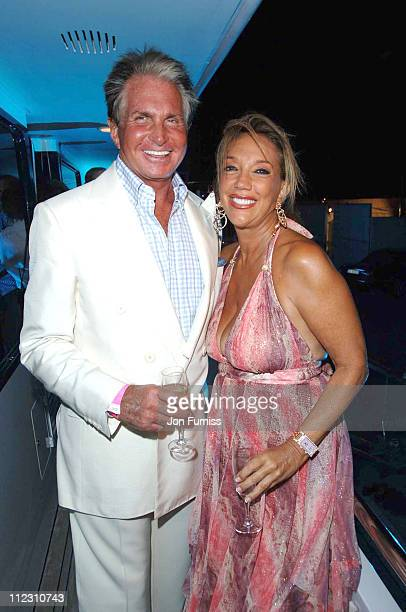 George Hamilton and Denise Rich during Denise Rich's Annual Summer Party Inside in St Tropez France