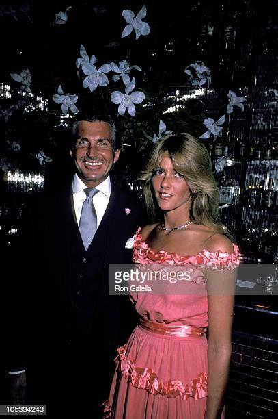 George Hamilton and girlfriend Liz Treadwell during Regine's 7th Anniversary Party at Regine's in New York City New York United States