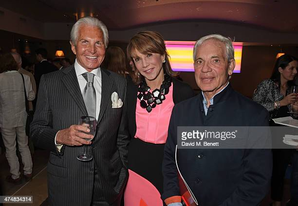 George Hamilton Mila Mulroney and Simon Reuben attend an after party celebrating the VIP Gala Preview of The Elephant Man at The Haymarket Hotel on...