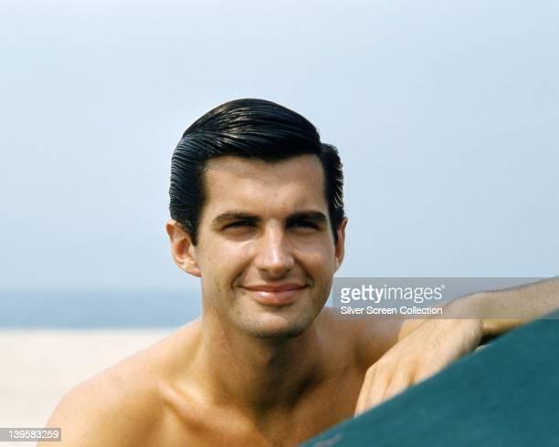 George Hamilton US actor smiling bare chested circa 1965