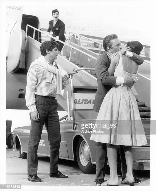 George Hamilton watches as Kirk Douglas kisses Daliah Lavi goodbye in a scene from the film 'Two Weeks In Another Town' 1962