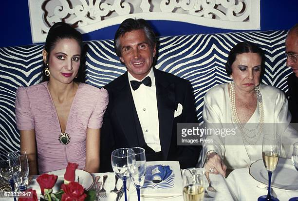 George Hamilton with his mother Ann Stevens his date attend the Grand Opening of newly refurbished Club El Morocco circa 1987 in New York City