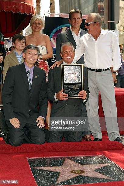 George Hamilton with partner Barbara Sturm son GT Hamilton and actor/friend James Caan is honored on the Hollywood Walk Of Fame on August 12 2009 in...