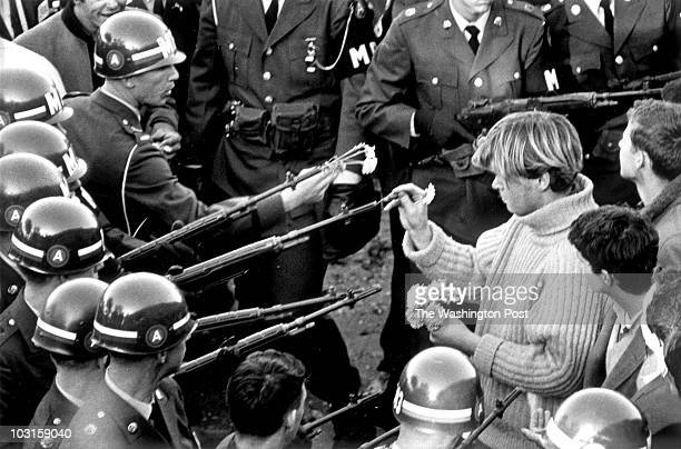 Antiwar demonstrators tried flower power on MPs blocking the Pentagon Building in Arlington VA on October 21 1967