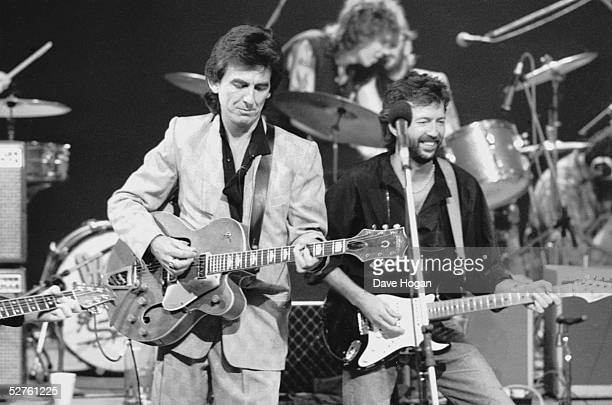 George Harrison and Eric Clapton at Limehouse Studios in London during recording of the TV programme 'Blue Suede Shoes' spotlighting veteran...