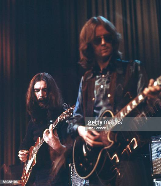 George Harrison and Eric Clapton perform on stage with Delaney and Bonnie in Copenhagen Denmark in December 1969