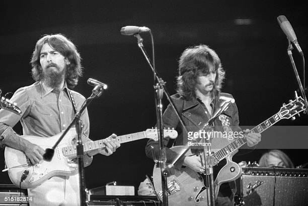 George Harrison and Eric Clapton performing at the Concert for Bangladesh at Madison Square Garden.
