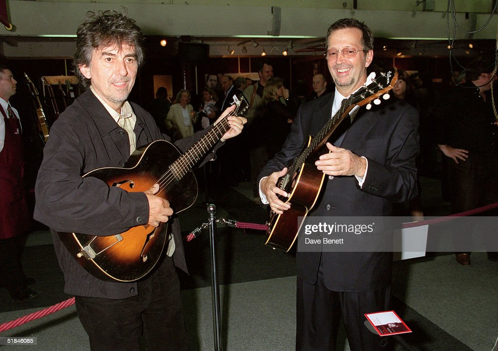George Harrison (L) and Eric Clapton play some of the guitars on offer at Christie's Auction on June 24 at Christie's. The auction is to raise money for the Crossroad's Centre in Antigua, a foundation that treats alcoholics and drug abusers in the Caribbean, June 03, 1999 in New York.