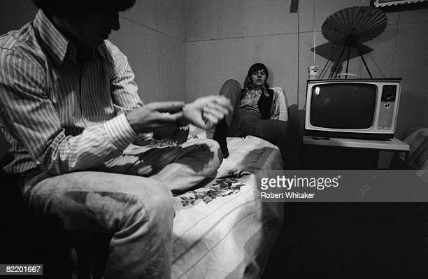 George Harrison and Ringo Starr in their dressing room before a Beatles concert at the Rizal Memorial Football Stadium Manila Philippines during the...