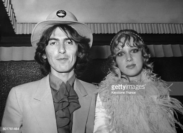 George Harrison and Wife Patti arrive at London Pavilion for the premiere of the Beatles movie 'The Yellow Submarine' on July 18 1968 in London...