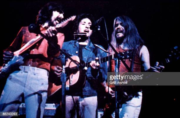 George Harrison, Bob Dylan and Leon Russell perform onstage at the Concert for Bangladesh which was held at Madison Square Garden on August 1, 1971...