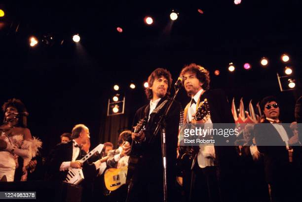 George Harrison, Bob Dylan and Little Richard performing at the 1988 Rock & Roll Hall Of Fame awards ceremony at the Waldorf Astoria Hotel in New...