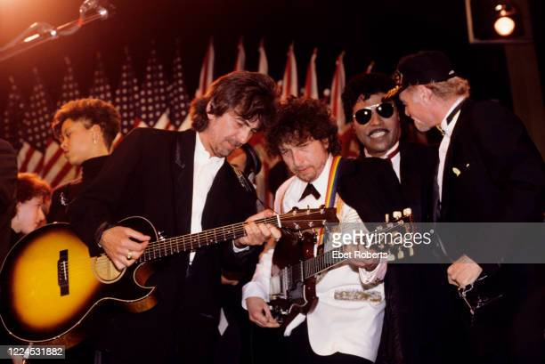 George Harrison, Bob Dylan, Little Richard and Mike Love of The Beach Boys performing at the 1988 Rock & Roll Hall Of Fame awards ceremony at the...