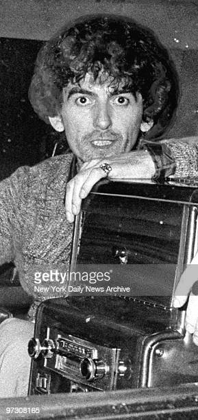 George Harrison in back of a limo