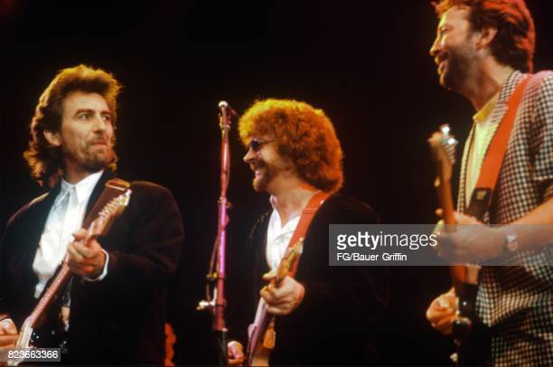 George Harrison, Jeff Lynne and Eric Clapton at the Princes Trust Concert on June 05, 1987 in London, United Kingdom. 170612F1