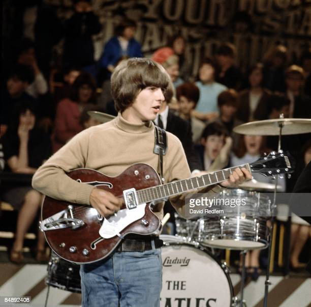 George Harrison of English rock and pop group The Beatles performs on stage during rehearsals for the ABC Television music television show 'Thank...