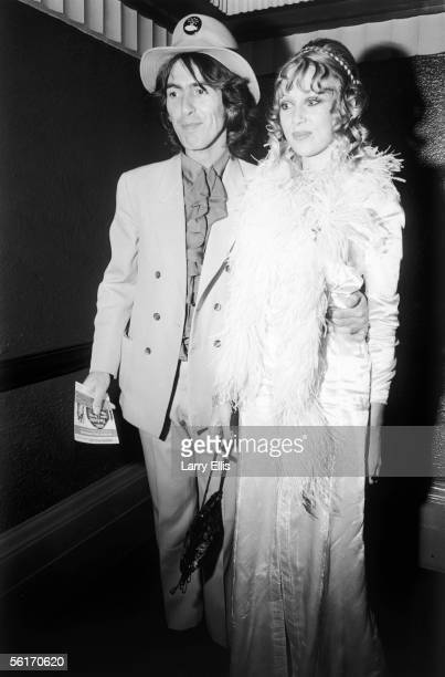 George Harrison of the Beatles and his wife Patti Boyd arrive at the London Pavilion for the world premiere of the new Beatles film 'Yellow...