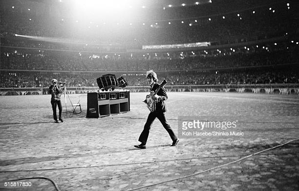 George Harrison of The Beatles walks across the field towards the stage at Dodger Stadium Los Angeles California August 28 1966