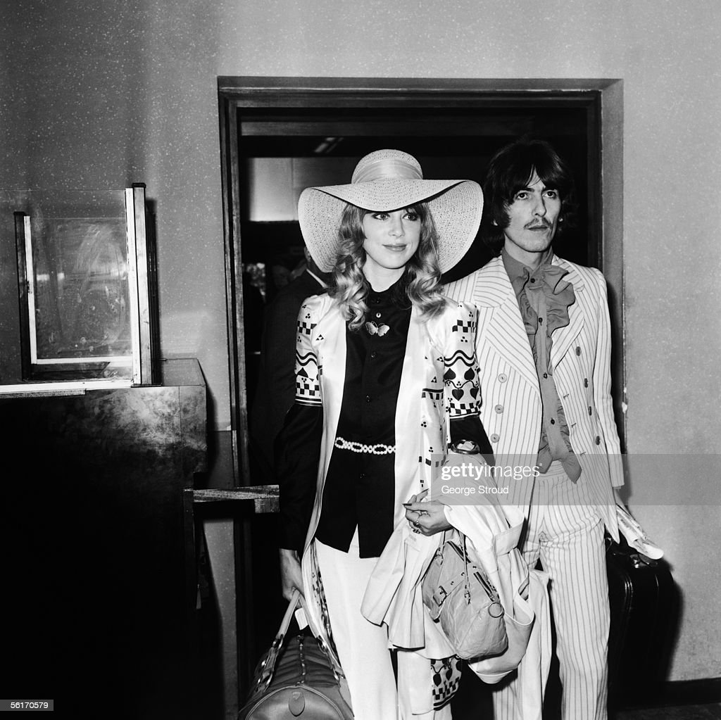 George Harrison (1943 - 2001) of the Beatles with his wife, model Patti Boyd at London Airport, on their way to the Cannes film festival, 16th May 1968.