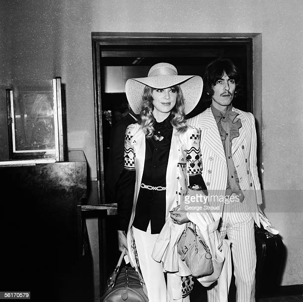 George Harrison of the Beatles with his wife model Patti Boyd at London Airport on their way to the Cannes film festival 16th May 1968
