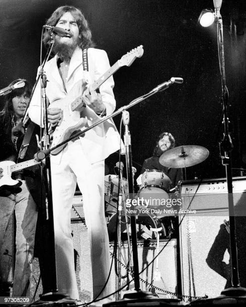 George Harrison on guitar and Ringo Starr on drums belt out some of the songs made famous by the Beatles before capacity crowd attending afternoon...