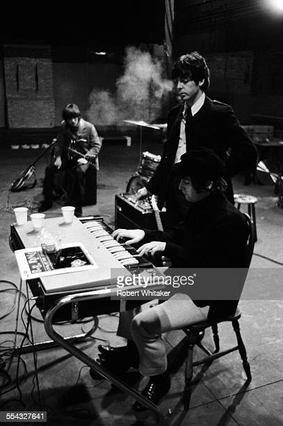 George Harrison Paul McCartney and John Lennon are pictured at the Donmar Rehearsal Theatre in central London during rehearsals for The Beatles...