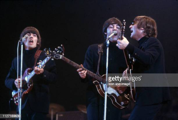 George Harrison Paul McCartney and John Lennon of The Beatles perform at Empire Pool in Wembley at the New Musical Express Annual Poll Winner's...